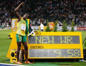 BERLIN - AUGUST 16: Usain Bolt of Jamaica celebrates winning the gold medal in the men's 100 Metres Final during day two of the 12th IAAF World Athletics Championships at the Olympic Stadium on August 16, 2009 in Berlin, Germany. Bolt set a new World Record of 9.58. (Photo by Andy Lyons/Getty Images)